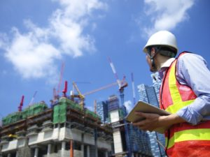 Construction worker examining his building